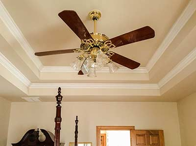 Nope... not a plumbing fixture! But knowing which way to run your fan can save you energy year round.